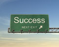 Sign with the words Success next right