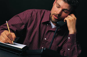 man providing telephone support